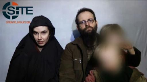 In this undated video grab provided by Site Intelligence Group and released by AFP in October 2017, hostages Caitlan Coleman (L) and her husband Joshua Boyle speak to the camera holding their children in an undisclosed location