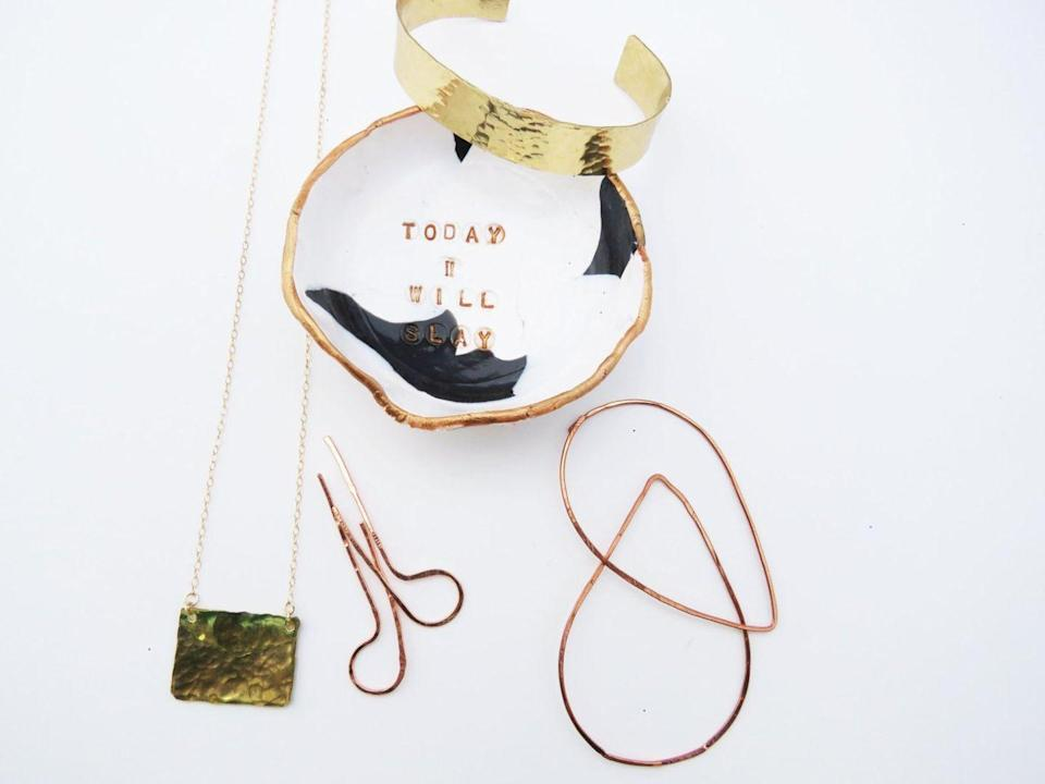 """<p><a class=""""link rapid-noclick-resp"""" href=""""https://go.redirectingat.com?id=74968X1596630&url=https%3A%2F%2Fwww.etsy.com%2Fshop%2Fthepinklocket&sref=https%3A%2F%2Fwww.housebeautiful.com%2Fshopping%2Fbest-stores%2Fg32768555%2Fblack-owned-etsy-shops%2F"""" rel=""""nofollow noopener"""" target=""""_blank"""" data-ylk=""""slk:SHOP NOW"""">SHOP NOW</a></p><p><a href=""""https://go.redirectingat.com?id=74968X1596630&url=https%3A%2F%2Fwww.etsy.com%2Fshop%2Fthepinklocket&sref=https%3A%2F%2Fwww.housebeautiful.com%2Fshopping%2Fbest-stores%2Fg32768555%2Fblack-owned-etsy-shops%2F"""" rel=""""nofollow noopener"""" target=""""_blank"""" data-ylk=""""slk:The Pink Locket"""" class=""""link rapid-noclick-resp"""">The Pink Locket</a>, a shop based in Atlanta, is a great resource for modern handmade jewelry—perfect if you're looking for a place to buy unique gifts. You'll also find these <a href=""""https://go.redirectingat.com?id=74968X1596630&url=https%3A%2F%2Fwww.etsy.com%2Flisting%2F479530824%2Fconfident-women-jewelry-dish-black-and&sref=https%3A%2F%2Fwww.housebeautiful.com%2Fshopping%2Fbest-stores%2Fg32768555%2Fblack-owned-etsy-shops%2F"""" rel=""""nofollow noopener"""" target=""""_blank"""" data-ylk=""""slk:fun ring dishes"""" class=""""link rapid-noclick-resp"""">fun ring dishes</a>, which double as storage and decor. Owner Kamilah writes in the shop description that, she """"comes from a very culturally rich background since she was born in Jamaica and raised in the US, so her inspiration comes from art, shapes, city landscapes, and even customers.""""</p>"""