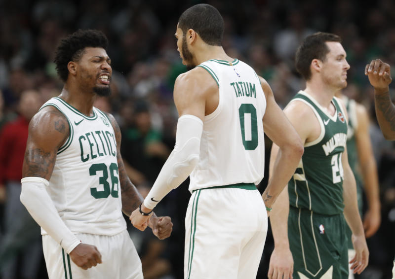 Celtics Marcus Smart and Jayson Tatum celebrate during a statement win over the Bucks. (Reuters)