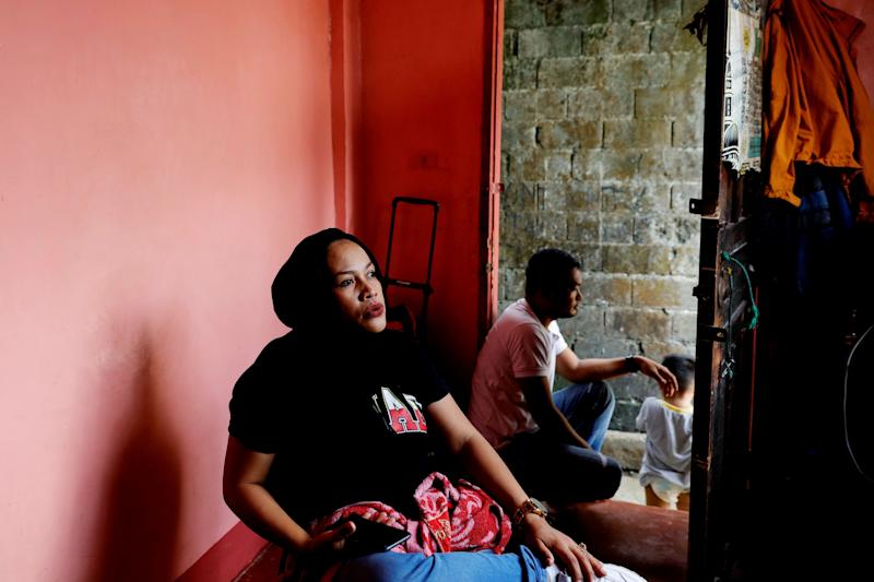 Noronisah Laba Gundarangin, 40, sits inside her sister's home in Marawi City, Lanao del Sur province, Philippines. (Photo: Eloisa Lopez/Reuters)