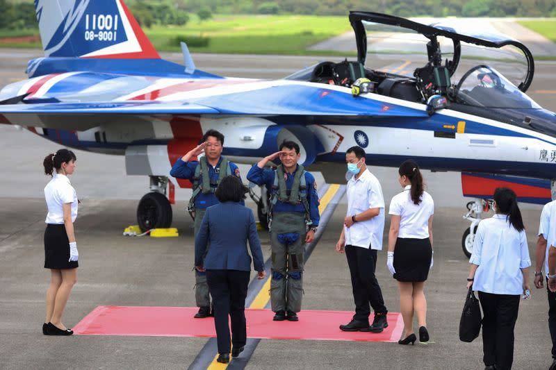Taiwanese President Tsai Ing-Wen walks towards the AIDC T-5 Brave Eagle, Taiwan's first locally manufactured advanced jet trainer, in Taichung