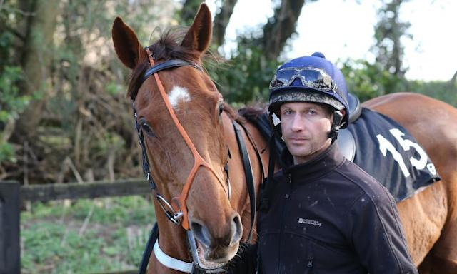 "<span class=""element-image__caption"">Danny Cook and Definitly Red, who is expected to go off favourite for next week's Grand National.</span> <span class=""element-image__credit"">Photograph: John Grossick/racingfotos.com/Rex/Shutterstock</span>"