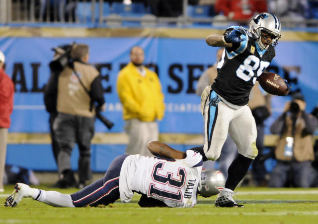 Carolina Panthers' Steve Smith (89) is tackled by New England Patriots' Aqib Talib (31) during the first half of an NFL football game in Charlotte, N.C., Monday, Nov. 18, 2013. (AP Photo/Mike McCarn)