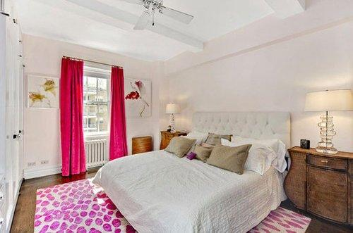 The apartment of Sex and the City creator Candace Bushnell is sophisticated and polished. Neutral bedding and side tables provide the perfect, simple backdrop to hot-pink curtains and patterned rugs in her bedroom - a contrast Carrie Bradshaw would definitely appreciate. Source: Ann Weintraub Ltd