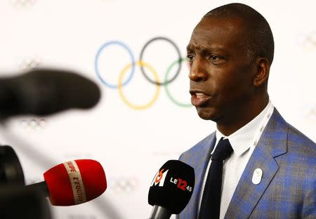 American sprinter Michael Johnson talks to media at the briefing of 2024 Olympic Games candidate cities Paris and Los Angeles ahead of final election of 2024 Olympic host city, in Lausanne, Switzerland July 11, 2017. REUTERS/Pierre Albouy