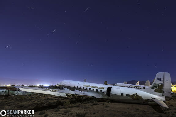 "Astrophotographer Sean Parker produced this image of Quandrantid meteors over Tucson, AZ, on Jan. 3, 2013. He writes: ""The boneyard [aircraft graveyard] is run by the [Davis-Monthan] Air Force base which requires clearance, and is surrounded by"