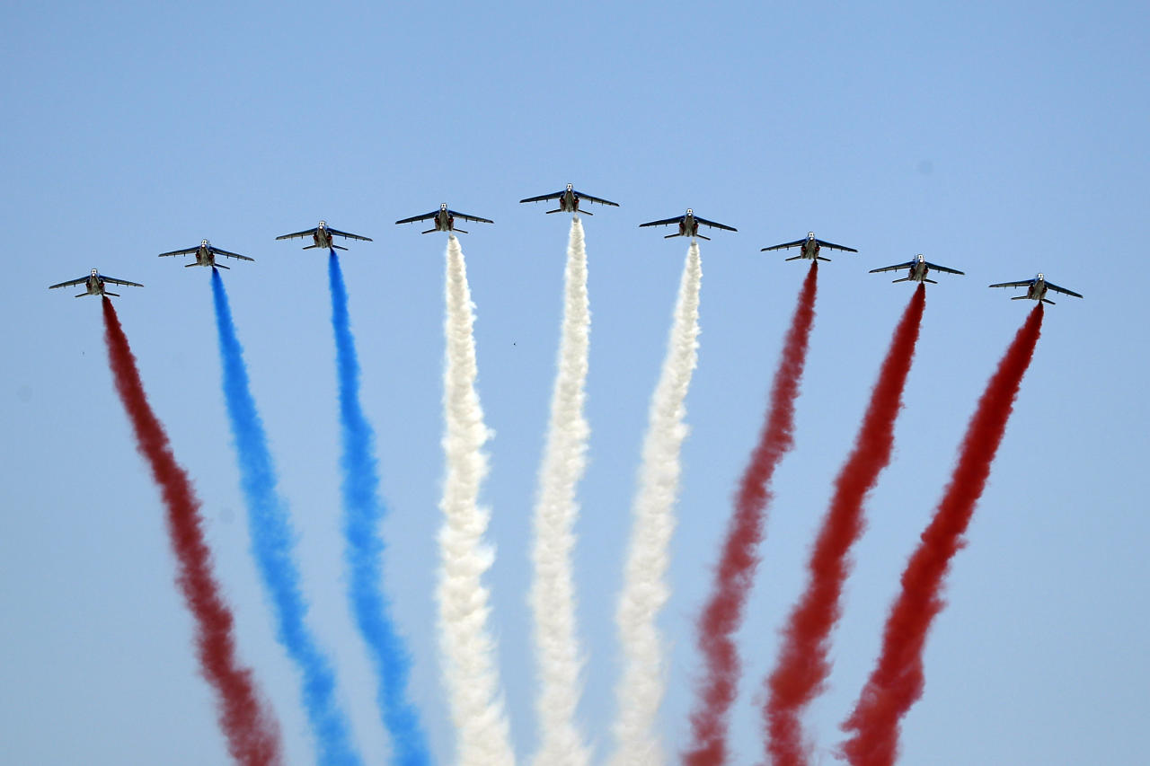 <p>French Alpha jets of the Patrouille de France spray lines of smoke in the colors of the French flag, with the last jet on left shooting red smoke instead of blue, during the Bastille Day parade in Paris, France, Saturday, July 14, 2018. An Air Force official confirmed to France-2 television that it was a mistake. (Photo: Francois Mori/AP) </p>