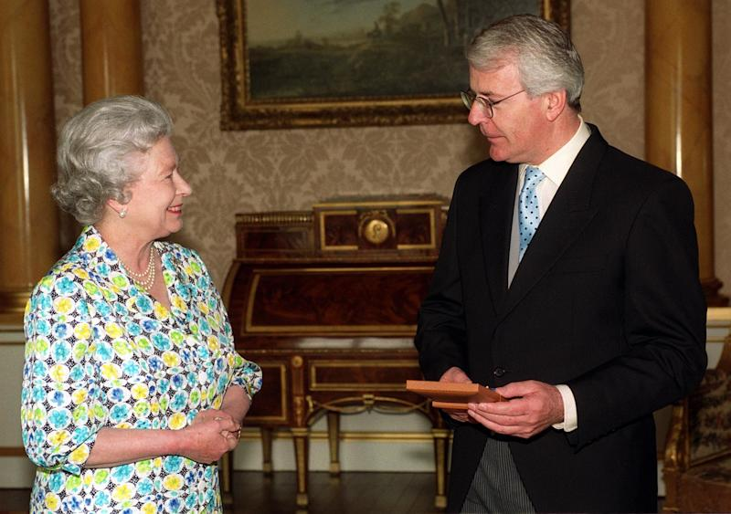 Former Prime Minister John Major receives the Companion of Honour from The Queen, at Buckingham Palace in London.