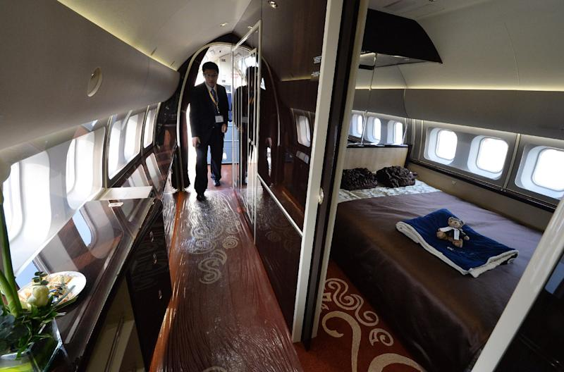 A Chinese businessman inside a private jet for sale during the Asian Business Aviation Conference and Exhibition Shanghai Hongqiao airport (AFP Photo/Mark Ralston)
