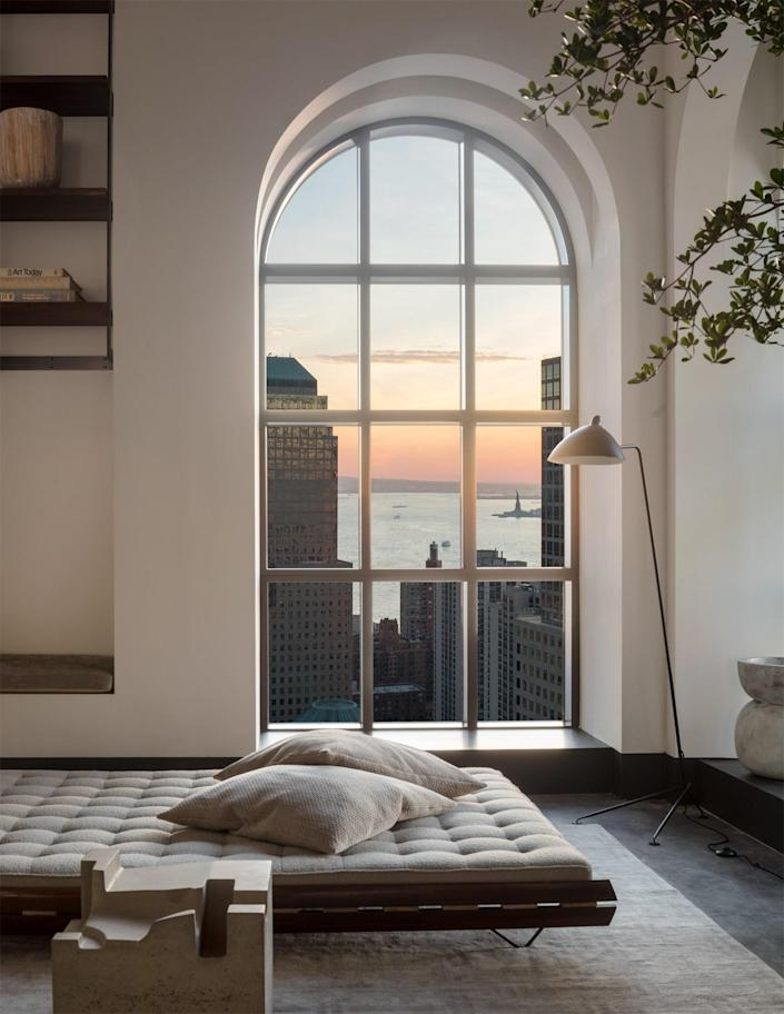 """""""From the windows you can view the Hudson River, the Statue of Liberty, and the Empire State Building, and, of course, those kinds of views end up being the ultimate focal points of the residence,"""" Ford says. He endeavored to select furnishings and art that complement the sweeping views."""