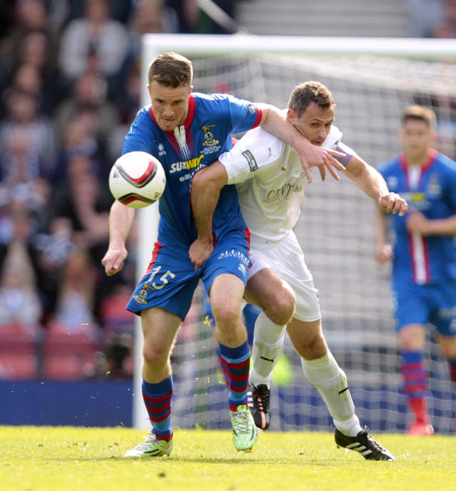 "Football - Falkirk v Inverness Caledonian Thistle - William Hill Scottish FA Cup Final - Hampden Park, Glasgow, Scotland - 30/5/15 Inverness Caledonian Thistle's Marley Watkins (L) in action with Falkirk's David McCracken Action Images via Reuters / Graham Stuart Livepic EDITORIAL USE ONLY. No use with unauthorized audio, video, data, fixture lists, club/league logos or ""live"" services. Online in-match use limited to 45 images, no video emulation. No use in betting, games or single club/league/player publications. Please contact your account representative for further details."