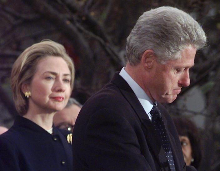 Then-President Bill Clinton, with first lady Hillary Clinton, thanks House Democrats who voted against impeachment on Dec. 19, 1998, at the White House in Washington, D.C.