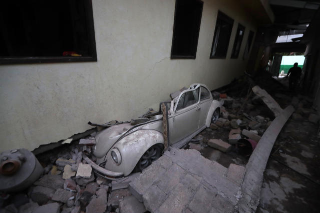 <p>A car sits crushed from a building felled by a 7.1 earthquake, in Jojutla, Morelos state, Mexico, Sept. 20, 2017. (Photo: Eduardo Verdugo/AP) </p>