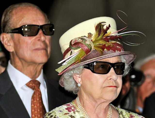 Queen Elizabeth II and the Duke of Edinburgh wearing 3D glasses to watch a 3D film, at the Pinewood Studios in Toronto in 2010. (PA Images)