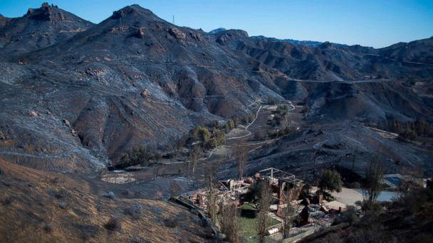 PHOTO: The Santa Monica Mountains are seen left blackened by the Woolsey Fire near Malibu, Calif., Nov. 14, 2018. (David Mcnew / AFP / Getty Images)