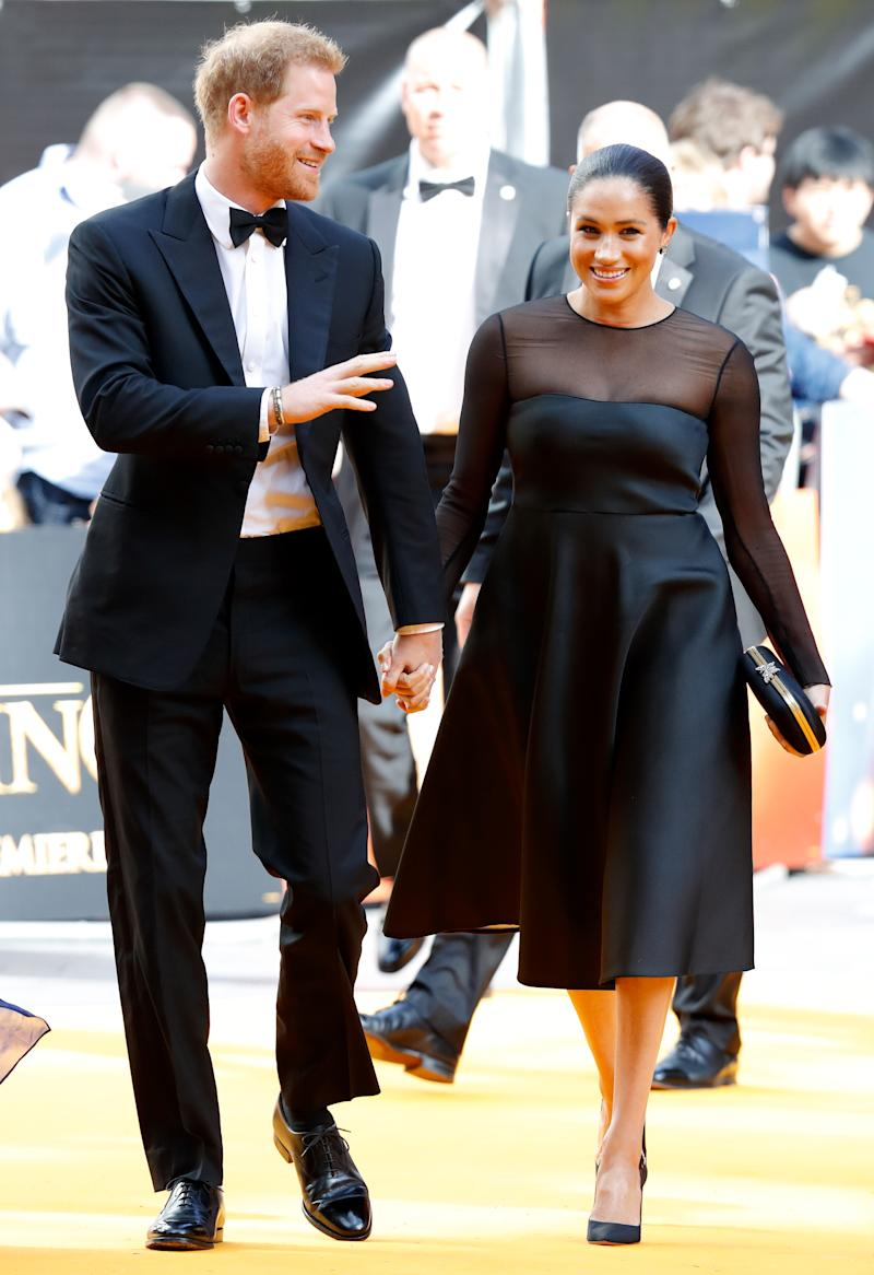 """Prince Harry, Duke of Sussex and Meghan, Duchess of Sussex attend """"The Lion King"""" European Premiere at Leicester Square on July 14, 2019 in London, England."""