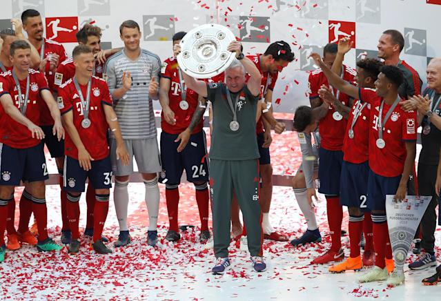 Soccer Football - Bundesliga - Bayern Munich v VfB Stuttgart - Allianz Arena, Munich, Germany - May 12, 2018 Bayern Munich coach Jupp Heynckes celebrates winning the Bundesliga with the trophy REUTERS/Michaela Rehle DFL RULES TO LIMIT THE ONLINE USAGE DURING MATCH TIME TO 15 PICTURES PER GAME. IMAGE SEQUENCES TO SIMULATE VIDEO IS NOT ALLOWED AT ANY TIME. FOR FURTHER QUERIES PLEASE CONTACT DFL DIRECTLY AT + 49 69 650050