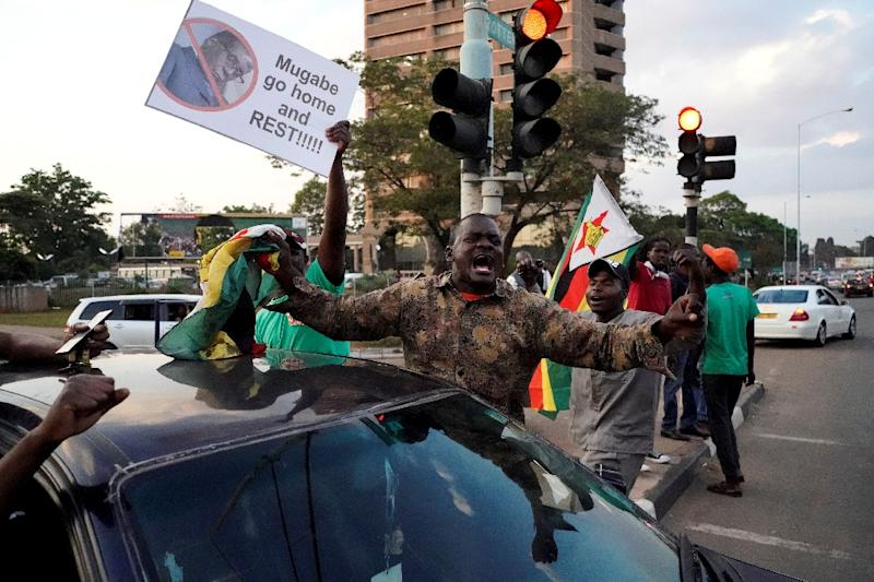 Zimbabweans took to the streets to celebrate when Robert Mugabe stepped down as president after 37 years in the power seat (AFP Photo/Marco LONGARI)