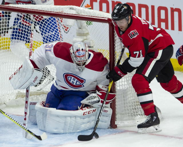 Ottawa Senators center Chris Tierney tries to stickhandle the puck past Montreal Canadiens goaltender Carey Price during the second period of an NHL game in Ottawa, Ontario, Saturday, Oct. 20, 2018. (Adrian Wyld/The Canadian Press via AP)
