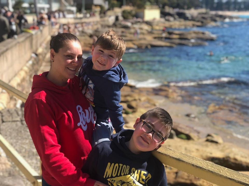 Pictured is Vanessa Brown and her sons, Tarek and Riley, by the beach.
