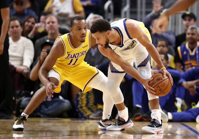 """Lakers guard Avery Bradley pressures Warriors guard Stephen Curry during a game earlier this season <span class=""""copyright"""">(Ezra Shaw / Getty Images)</span>"""