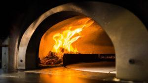 A shot inside the pizza oven that can go up to as high as 800 degrees fahrenheit. Photo: Coconuts