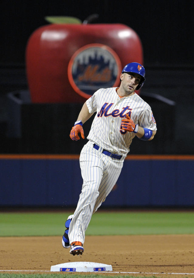 New York Mets' David Wright rounds third with a two-run home run during the first inning of a baseball game against the Philadelphia Phillies, Saturday, May 10, 2014, at Citi Field in New York. (AP Photo/Bill Kostroun)