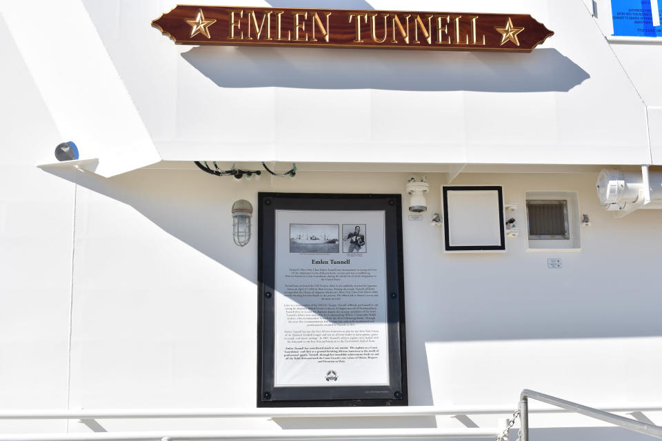 This undated photo provided by the United States Coast Guard shows a name plate and tribute plaque for Emlen Tunnell on a U.S. Coast Guard cutter docked in Bollinger Shipyard, Lockport, La. Tunnell, the first Black athlete inducted into the Pro Football Hall of Fame, served in the Coast Guard during and after World War II, where he was credited with saving the lives of two shipmates in separate incidents. Now, a Coast Guard cutter and an athletic building on the Coast Guard Academy campus are being named in honor of the former New York Giants defensive back. (United States Coast Guard via AP)