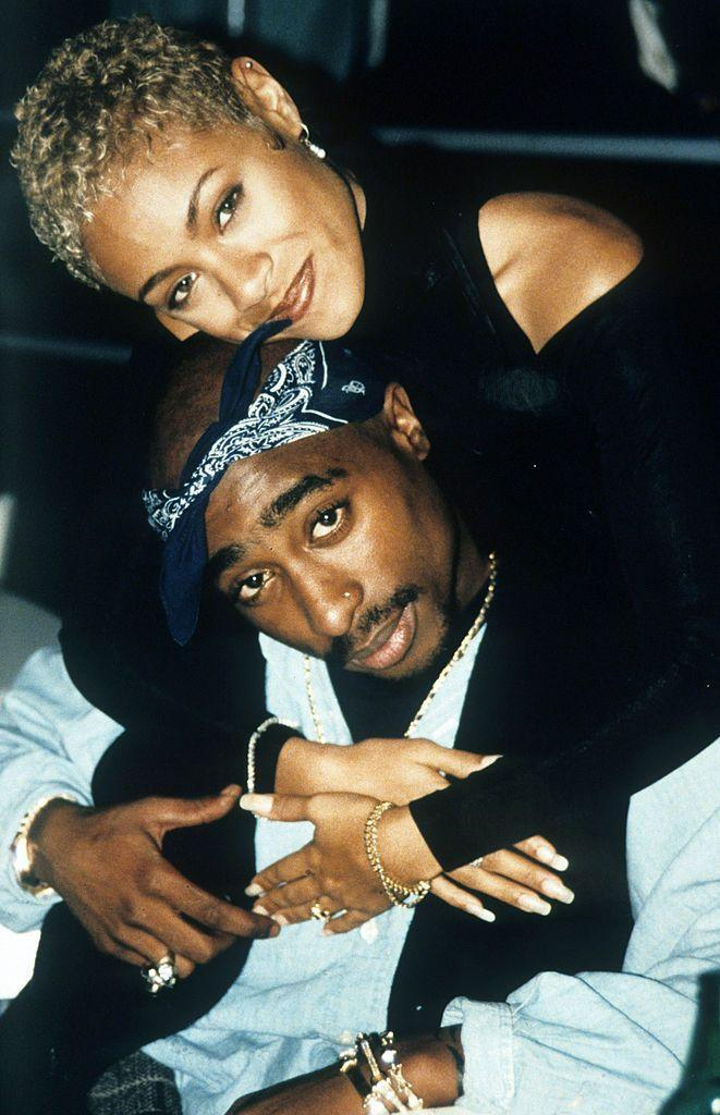 """<p>The actor and late rapper became close friends after meeting at the Baltimore School for the Arts. </p><p><a href=""""https://soundcloud.com/howardstern/jadapinkettsmith_tupac"""" rel=""""nofollow noopener"""" target=""""_blank"""" data-ylk=""""slk:Speaking to Howard Stern"""" class=""""link rapid-noclick-resp"""">Speaking to Howard Stern</a> in 2016, Pinkett discussed their very platonic friendship, saying 'there was no physical chemistry' between them but they were very close. </p><p>'It was hard enough just with us being friends, we had a very volatile relationship... I had never in my life met a person like Pac, he had so much charisma,' she said. </p>"""