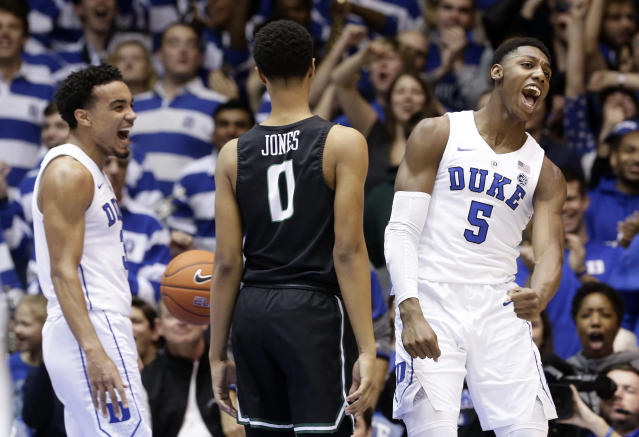 Duke's RJ Barrett (5) and Tre Jones, left, react following a dunk by Barrett while Stetson's Christiaan Jones (0) looks on during the first half of an NCAA college basketball game in Durham, N.C., Saturday, Dec. 1, 2018. (AP Photo/Gerry Broome)