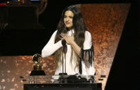 "Rosalia accepts the award for best Latin rock, urban, or alternative album for ""El Mal Querer"" at the 62nd annual Grammy Awards on Sunday, Jan. 26, 2020, in Los Angeles. (Photo by Matt Sayles/Invision/AP)"