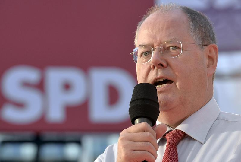 FILE- This is a Thursday, Sept. 5, 2013 file photo of Peer Steinbrueck, top candidate of the Social Democratic Party (SPD), speaking at a pre-election party in the city of Essen, western Germany. Peer Steinbrueck knows the view from the heights of German politics: Over four decades, he's worked at the chancellery, run the country's most populous state and helped steer Germany through the 2008 financial crisis as finance minister. (AP Photo/Martin Meissner, File)