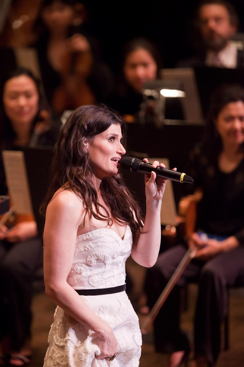 In this Feb. 5, 2011 publicity image released by the  New York Philharmonic, Idina Menzel performs with the New York Philharmonic at Avery Fisher Hall in New York.  (AP Photo/New York Philharmonic,  Chris Lee)