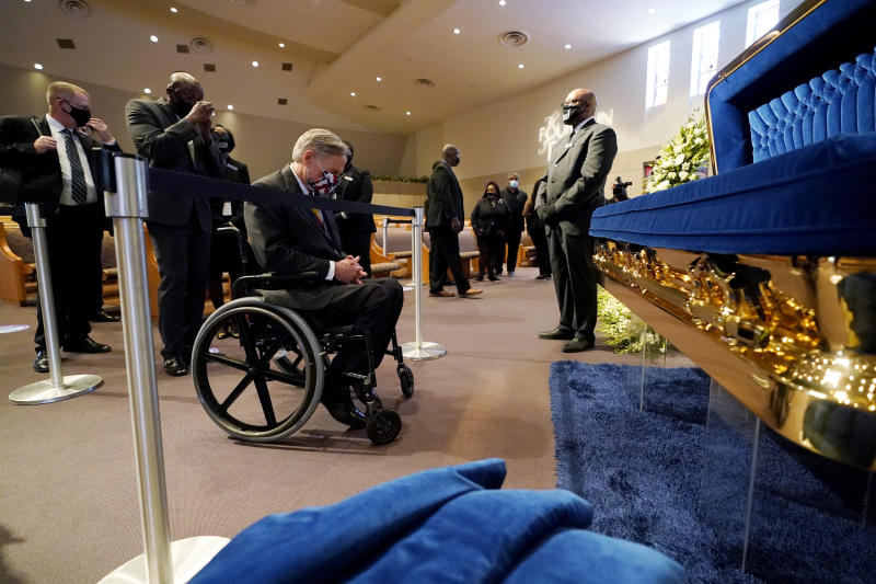 Image: Texas Gov. Greg Abbott pays his respects at the casket of George Floyd in Houston on June 8, 2020. (David J. Phillip / Pool via AP)