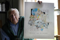 """Artist Robert Seaman holds up the 365th daily doodle sketch in his room at an assisted living facility Monday, May 10, 2021, in Westmoreland, N.H. Seaman, who moved into the facility weeks before the COVID-19 pandemic shutdown his outside world in 2020, recently completed his 365th daily sketch, or what he calls his """"Covid Doodles"""", since being isolated due to the virus outbreak. (AP Photo/Charles Krupa)"""