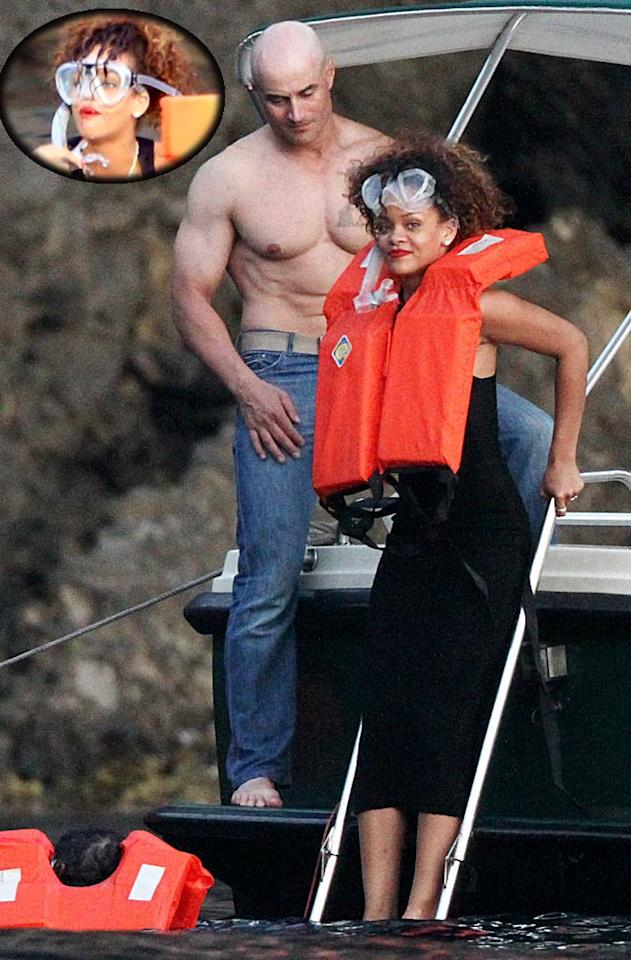 Even when fashion-focused Rihanna goes snorkeling she makes sure she still looks stylish. The pop star dove into the sea wearing red lipstick and a little black dress in Portofino, Italy, on Wednesday to get a peek at a submerged bronze statue of Jesus Christ. The pop star looked sea chic, but how about a bringing a bathing suit next time? Splash News/INFPhoto.com - August 24, 2011