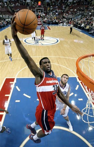 Washington Wizards' Chris Singleton (31) goes up for a dunk past Philadelphia 76ers' Spencer Hawes during the first half of an NBA basketball game, Friday, Jan. 13, 2012, in Philadelphia. (AP Photo/Matt Slocum)