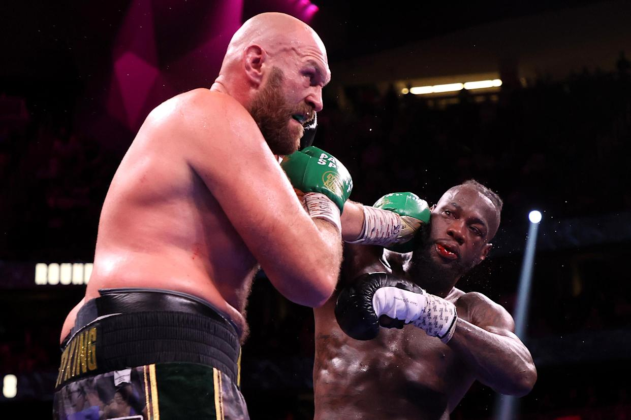 LAS VEGAS, NEVADA - OCTOBER 09: Tyson Fury (L) punches Deontay Wilder during their WBC heavyweight title fight at T-Mobile Arena on October 09, 2021 in Las Vegas, Nevada. (Photo by Al Bello/Getty Images)