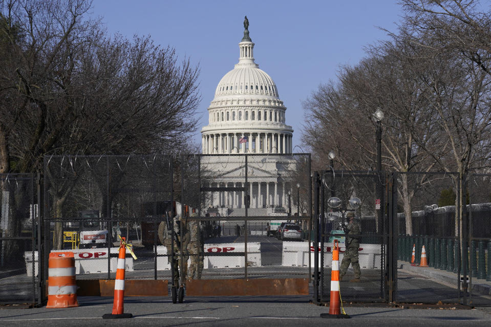 "Security fencing surrounds Capitol Hill in Washington, Thursday, March 4, 2021. Capitol Police say they have uncovered intelligence of a ""possible plot"" by a militia group to breach the U.S. Capitol on Thursday, nearly two months after a mob of supporters of then-President Donald Trump stormed the iconic building to try to stop Congress from certifying now-President Joe Biden's victory. (AP Photo/Susan Walsh)"
