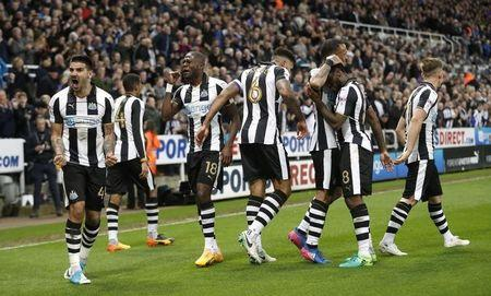 Newcastle's Jamaal Lascelles celebrates scoring their first goal with team mates