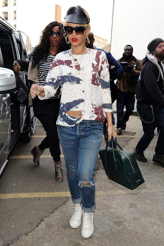 "Perry's pal, Rihanna, was also recently spotted in an equally atrocious outfit. The ""S&M"" songstress was photographed in London unsuccessfully attempting to resurrect the unfortunate visor trend of 2002. She then dared to pair her hideous black Fleet Ilya headpiece with a slashed sweatshirt and cuffed jeans. <br><br><a target=""_blank"" href=""http://bit.ly/lifeontheMlist"">Follow What Were They Thinking?! creator Matt Whitfield on Twitter!</a>"