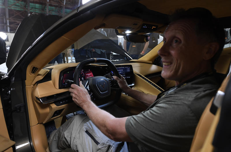 TUSTIN, CA - JULY 18: People take a closer look after the unveiling of the 2020 mid-engine C8 Corvette Stingray during a news conference on July 18, 2019 in Tustin, California. (Photo by Kevork Djansezian/Getty Images)