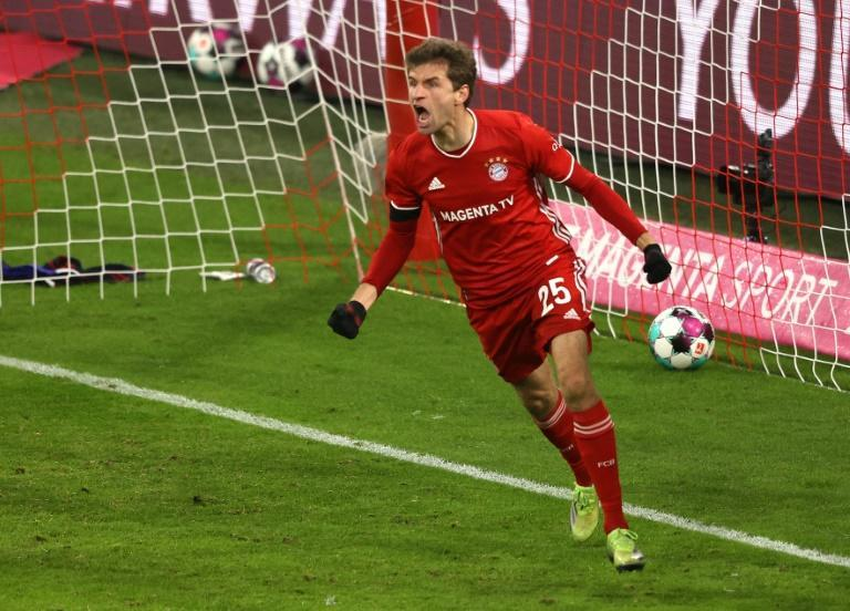 Thomas Mueller celebrates scoring the equaliser as Bayern Munich drew 3-3 at home with RB Leipzig on Saturday