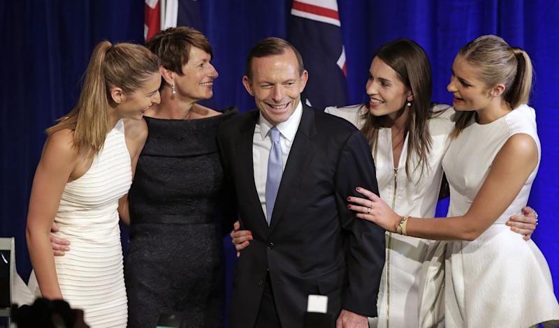 Australian opposition leader Tony Abbott, third left, and his daughters Frances, left, Louise, second right, and Bridget, right, and his wife Margaret, second left, come to the stage to celebrate his election victory in Sydney, Saturday, Sept. 7, 2013, following his win in Australia's national election. Australia's conservative opposition swept to power, ending six years of Labor Party rule and winning over a disenchanted public by promising to end a hated tax on carbon emissions, boost a flagging economy and bring about political stability after years of Labor infighting. (AP Photo/Rick Rycroft)