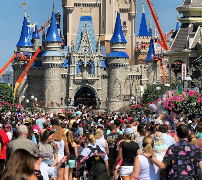 Disney's resort hotels are readying to open, a few weeks before crowds return to the Magic Kingdom at Walt Disney World in Lake Buena Vista, Fla. New precautions will be in place to reduce exposure to coronavirus.
