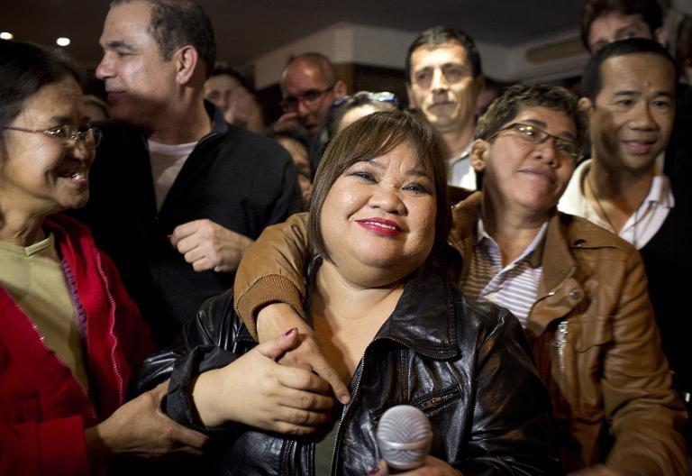 Rose Fostanes a Filipina migrant caregiver living in Israel, celebrates with friends and family in a bar in Tel Aviv, after she won the Israeli X-Factor on January 15, 2014