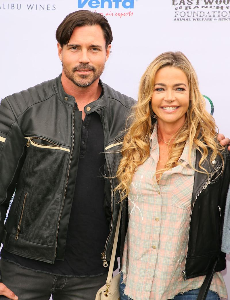 Denise Richards and husband, Aaron Phypers looks outstanding in leather jacket and denim pant to match