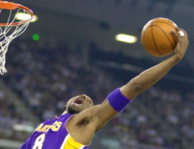 FILE - In this May 13, 2001 file photo Los Angeles Lakers' Kobe Bryant reaches back for a rebound during the first half of game four of the Western Conference semifinals against the Sacramento Kings in Sacramento, Calif. Bryant, a five-time NBA champion and a two-time Olympic gold medalist, died in a helicopter crash in California on Sunday, Jan. 26, 2020. He was 41. (AP Photo/Mark Terrill, file)