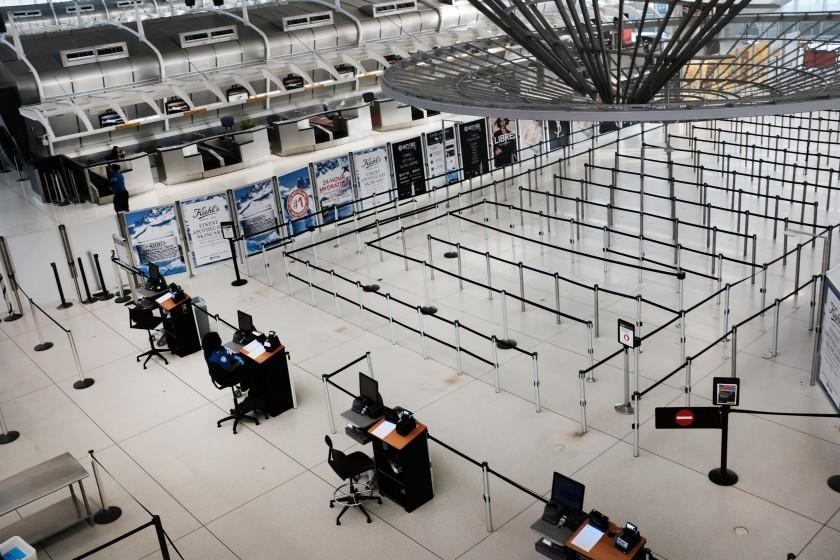NEW YORK, NEW YORK - MARCH 07: People walk through a sparse international departure terminal at John F. Kennedy Airport (JFK) as concern over the coronavirus grows on March 7, 2020 in New York City. The number of global coronavirus infections has now surpassed 100,000, causing disruptions throughout the globe. The airline and travel industries has been especially hard hit by the outbreak, with both business and leisure travelers cancelling plans. (Photo by Spencer Platt/Getty Images)
