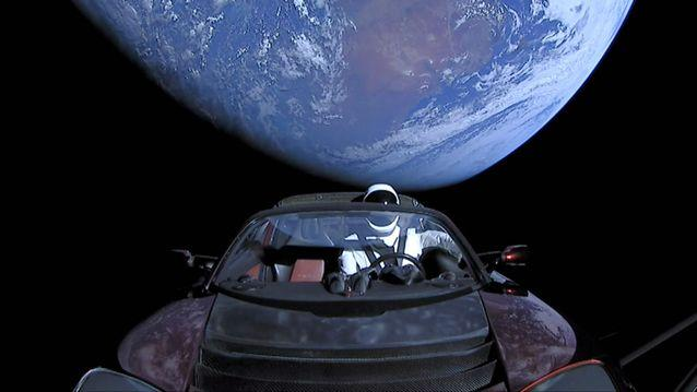 The Tesla roadster launched from the Falcon Heavy rocket with a dummy driver named 'Starman' heads towards Mars. Source: Getty
